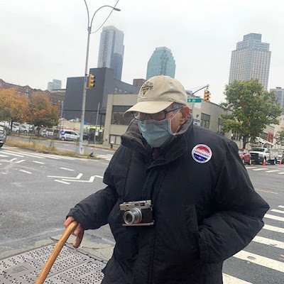 photo of Tony Vacaro walking in Long Island City to vote