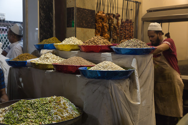 man selling dried fruits and nuts in Old Delhi India during ramzan