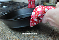 holding a pan with a handle cover