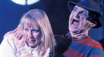 Freddy Kruger (Robert Englund) grabs Alice (Lisa Wilcox) so he can torture her in a movie scene for the film A Nightmare on Elm Street 5: The Dream Child