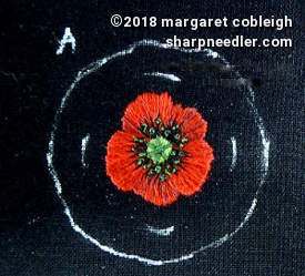Red embroidery remembrance with stitching completed. Ready to be cut and mounted in a pin setting.
