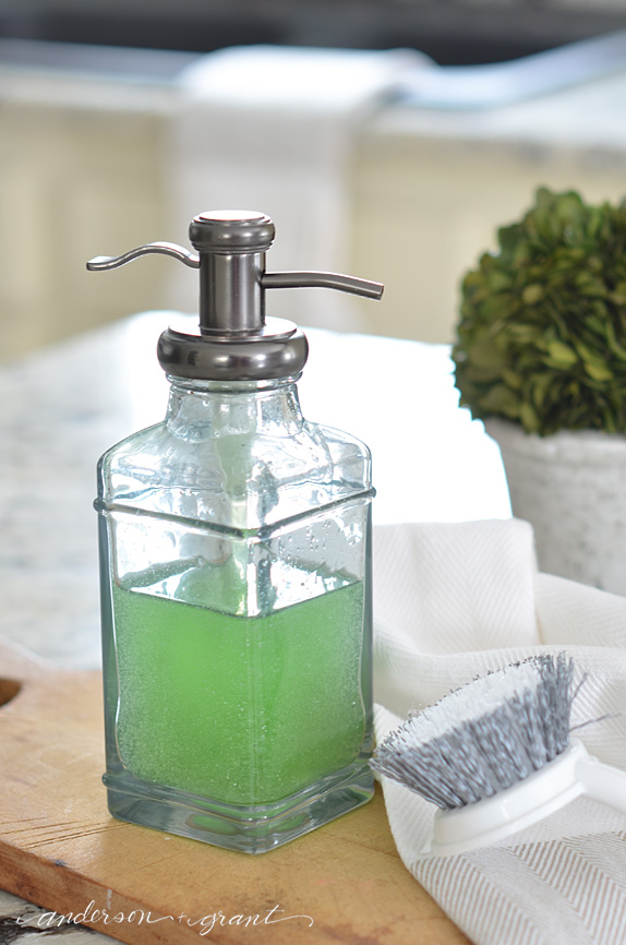Use a hand soap dispenser to hold dish detergent by your sink.  |  www.andersonandgrant.com