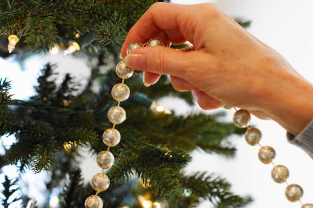 Hanging Gold Bead Garland on Christmas Tree Image
