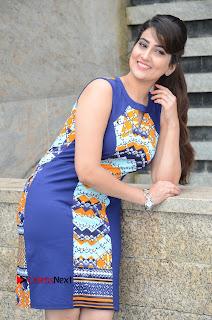 Actress Anchor Manjusha Pictures in Blue Short Dress at Jaguar Movie Success Meet .COM 0076.jpg