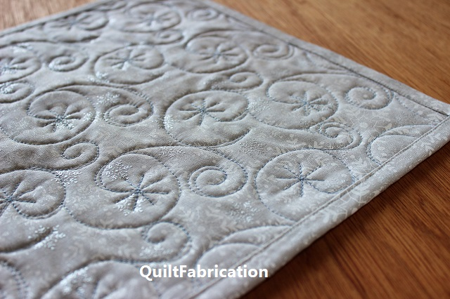 Holiday Star snowflake quilting backside by QuiltFabrication