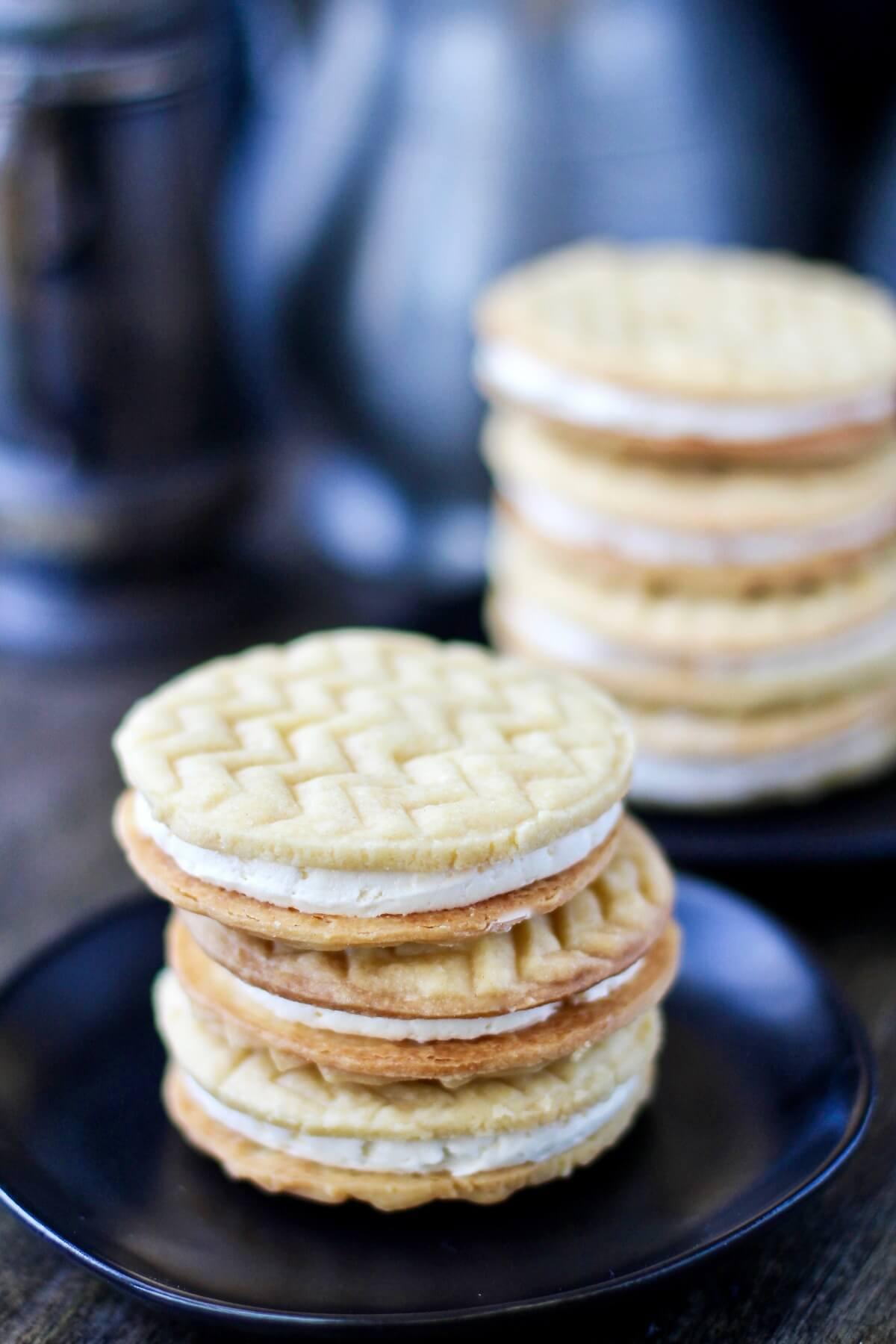 Custard Cream Sandwich Cookies stacked.