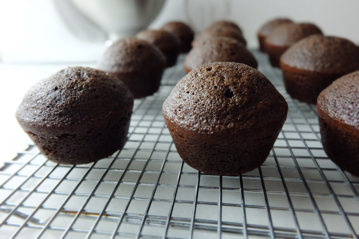 chocolate cupcakes cooling on rack