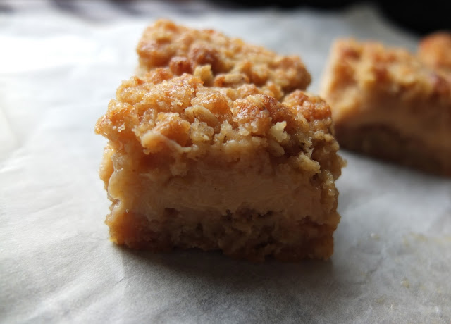 Close up image of a lemon crumb oat bar.