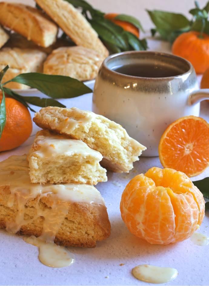 Recipe for cream scones flavored with satsuma mandarin orange juice and zest, topped with a mandarin orange glaze.