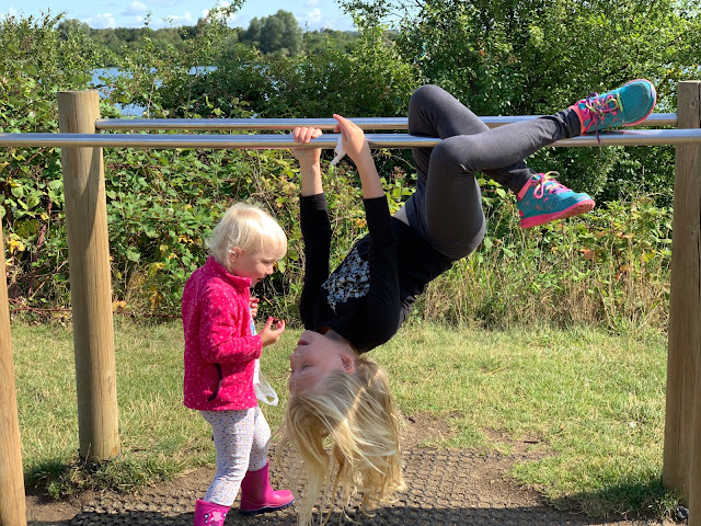 Children playing on parallel bars at Fairlop Waters Ilford