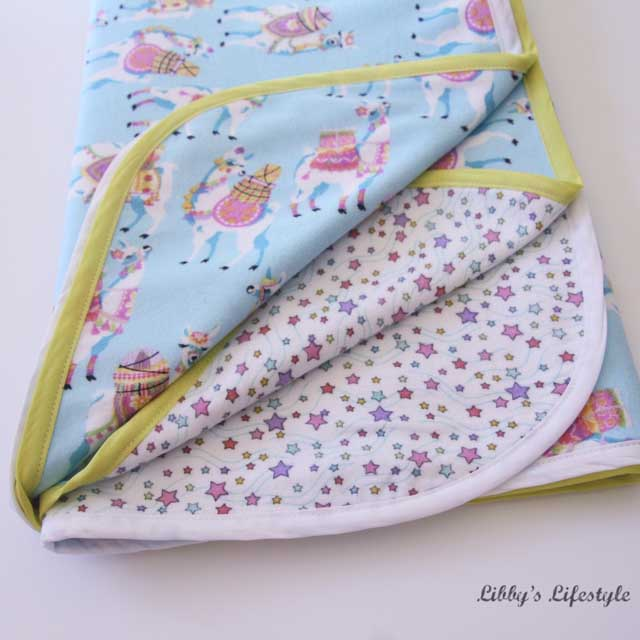 Learn how to easily make a receiving / swaddling blanket. Tutorial by Libby's Lifestyle
