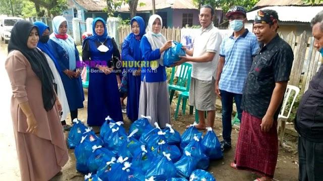 Ketua DPC Demokrat Bersama Iswara Salurkan Bantuan PIA DPR RI Pada Korban Banjir Bima