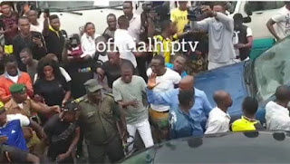 Naira Marley Causes A Security Breach As His Fans Mobbed Him & Almost Pushed A Police Officer Down