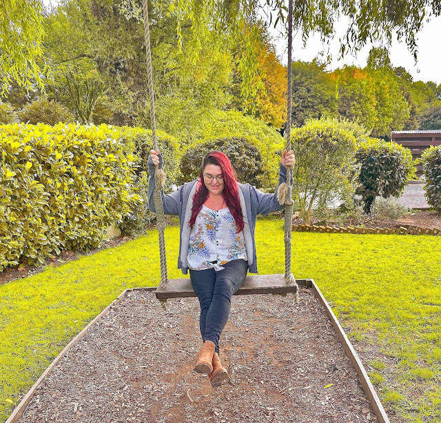 Becky on a swing at a hotel in South Wales