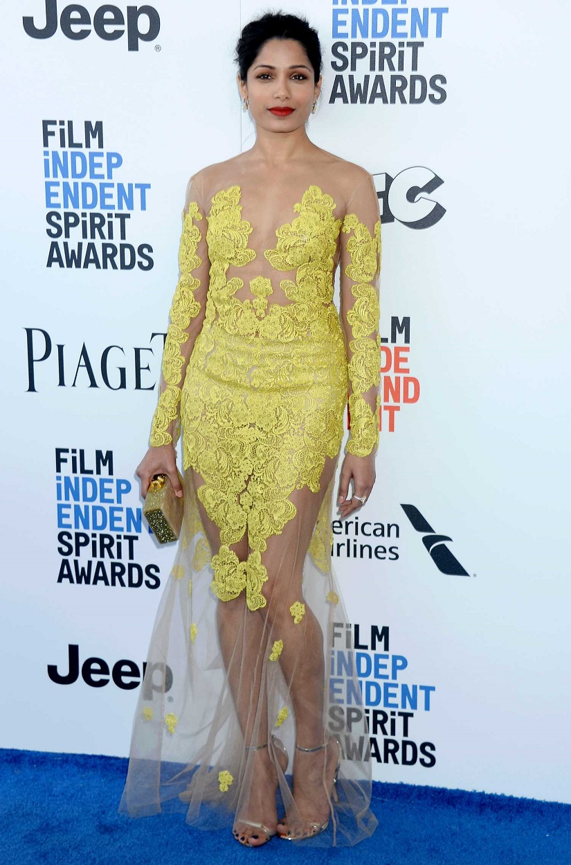Freida Pinto, 32, wore a golden-yellow lace illusion dress to the 32nd Independent Spirit Awards