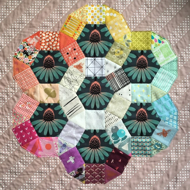 english paper pieced rainbow coloured modern quilt