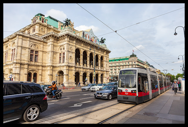 Tram 727, running on the number 2 route, rolls by the Vienna Opera House.