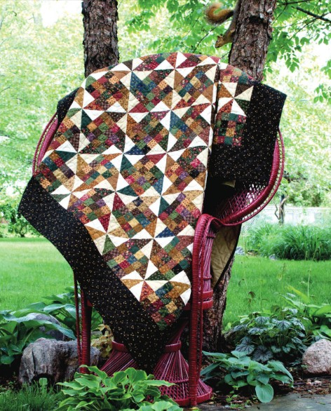Scrap Patch Paddlewheel Quilt Designed By Lynette Jensen, Published in Thimbleberries Scrap Quilt Magazine.