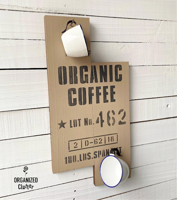 Photo of enamelware cups on an organic coffee sign