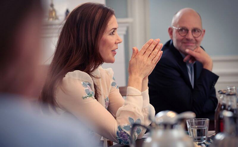 Crown Princess Mary wore a blue floral embroidered pussy bow neckline silk chiffon blouse from Prada