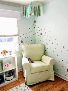 nursery with gold  and mint detail and tassel garland