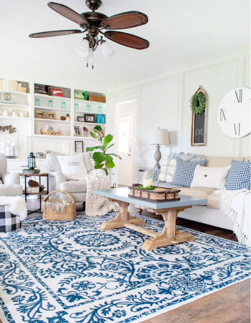 DIY Beautify living room with blue rug, light sofa and chairs and pillows and throws