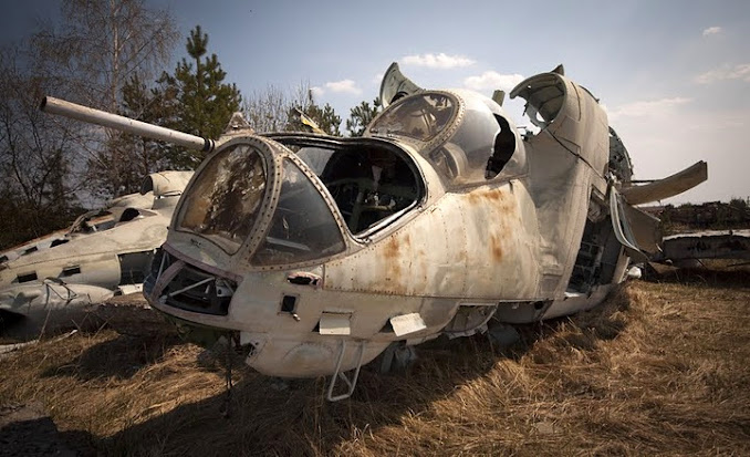 The remains of a Mil Mi-24 'Hind' Helicopter lies in a radioactive vehicle scrapyard near Chernobyl.