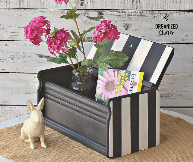 Photo of a recipe box upcycled with paint stripes in black and white.