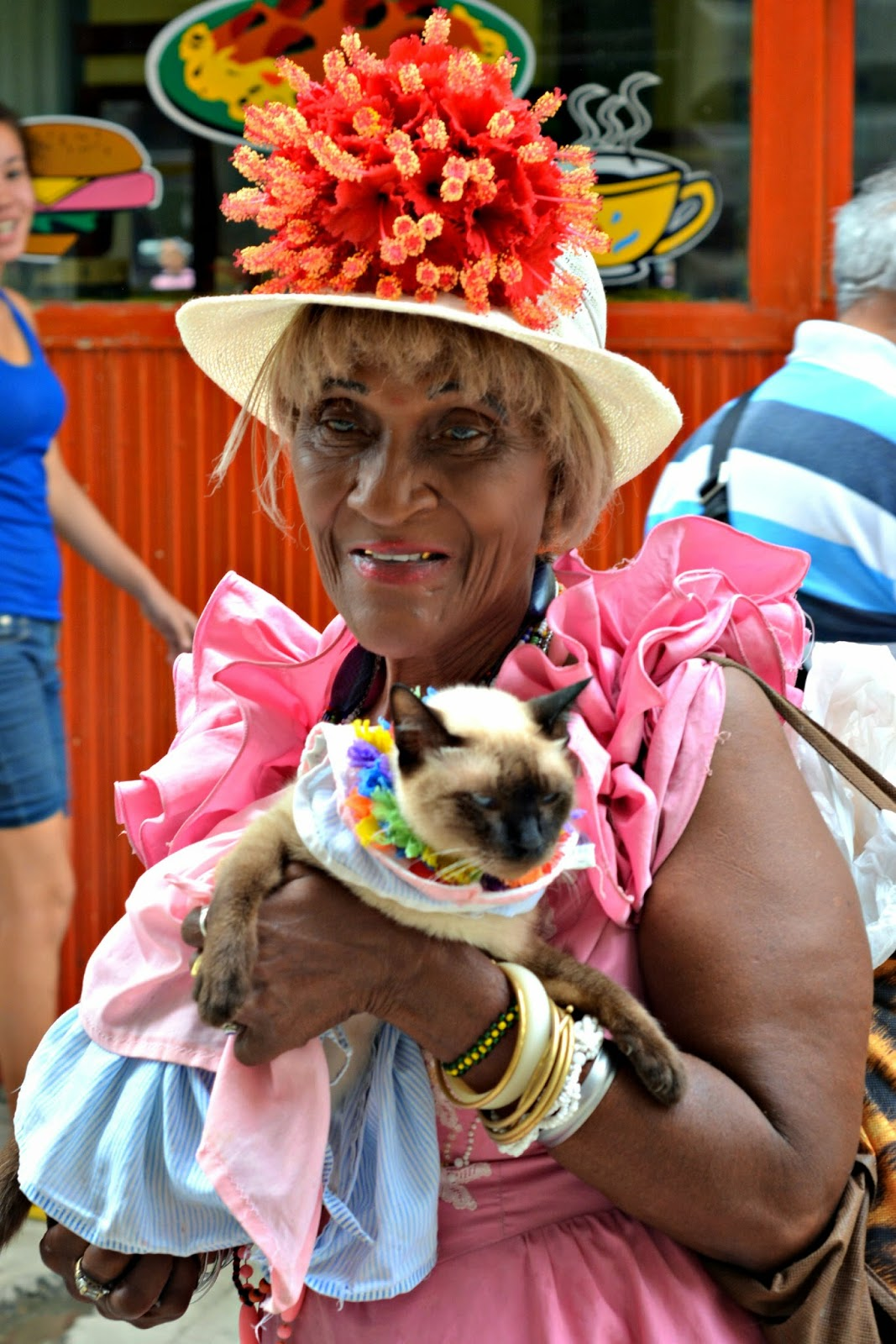 Colourful Cuban lady with her cat on the streets of Havana