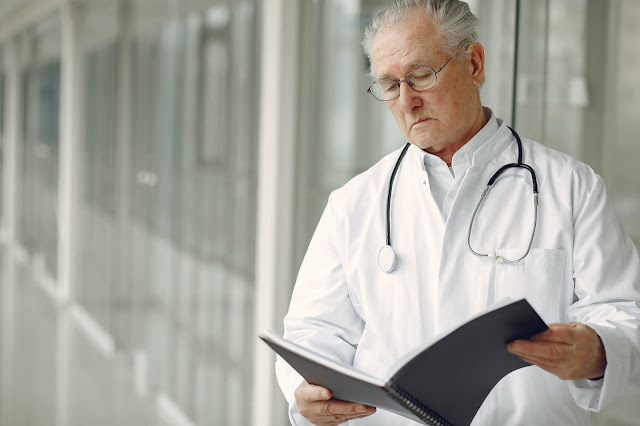 Doctor Reviewing File