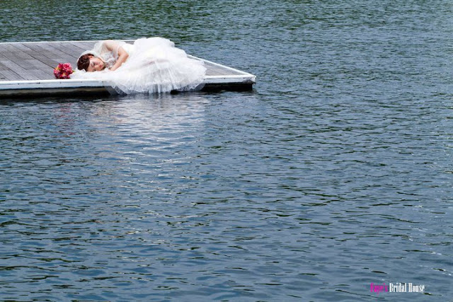 bride sleeping on a jetty