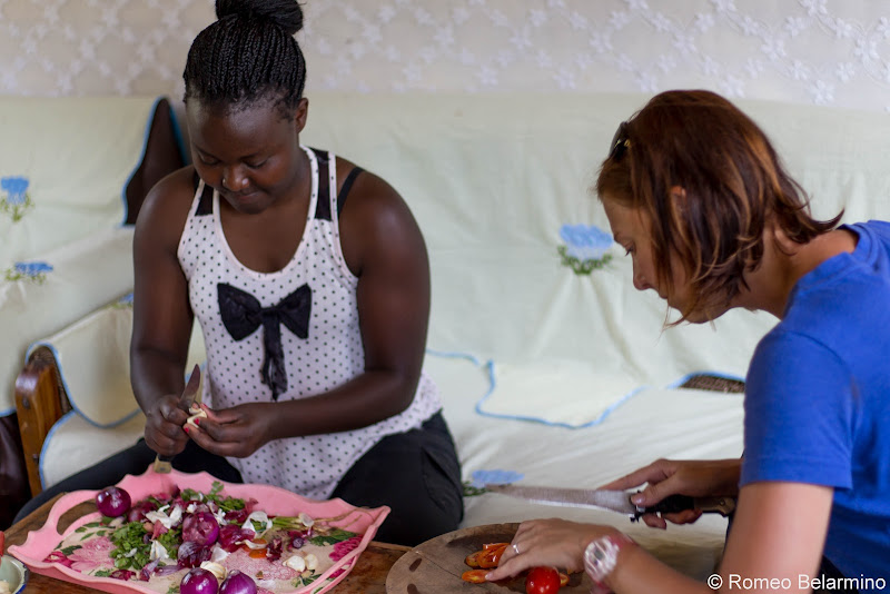 Katherine and Esther Chopping Vegetables Volunteering in Kenya with Freedom Global