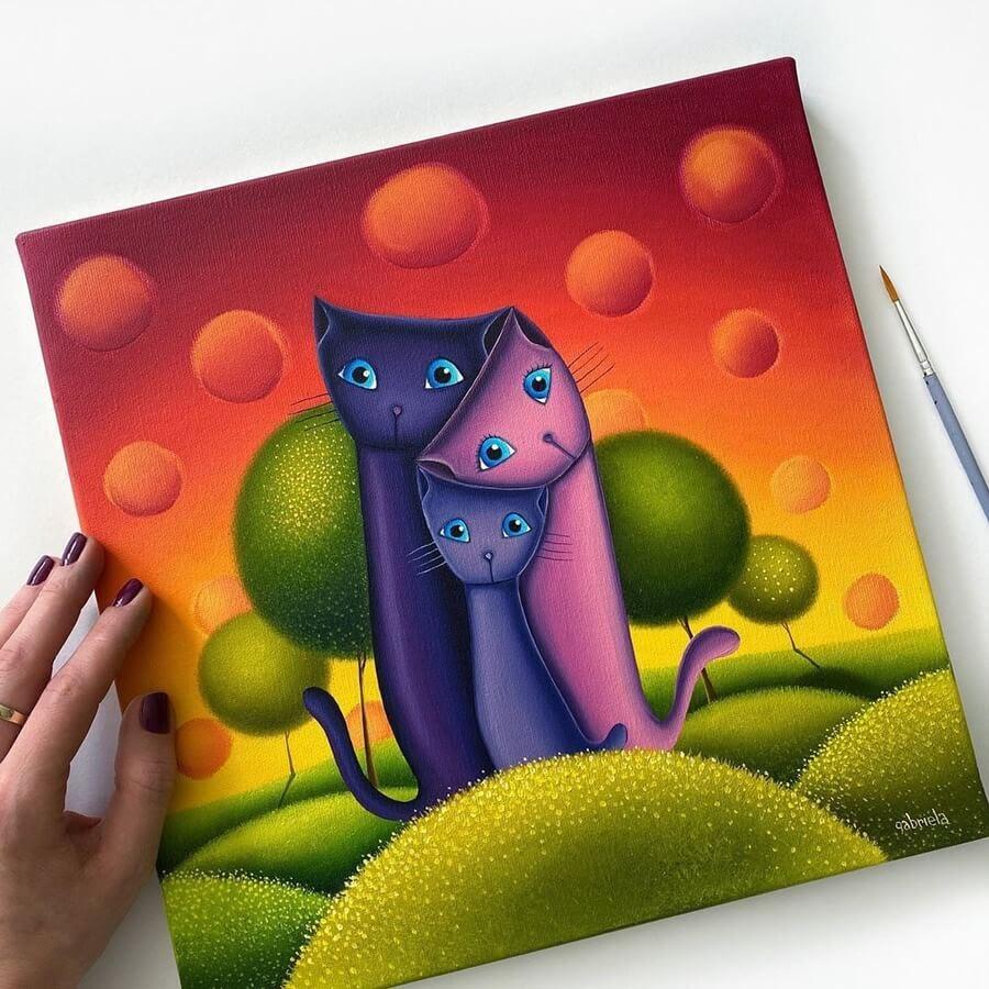 04-Cat-Family-Gabriela-Elgaafary-www-designstack-co