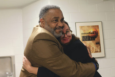 Anthony Ray Hinton, left, embraces Shannon Holliday, coordinator of Shepherd's Common Reading program. Photo by Emily Daniels.