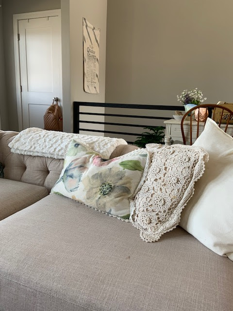 linen chesterfield sofa with floral pillows