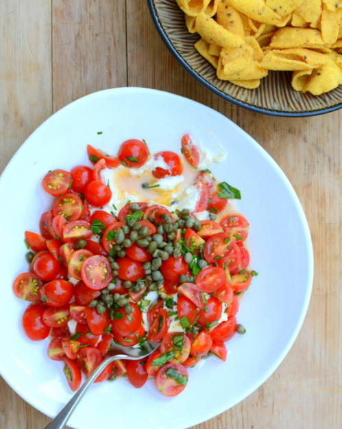 Warm Goat Cheese Appetizer with Mini Tomatoes & Capers, another easy summer appetizer ♥ KitchenParade.com, a big jumble of tangy goat cheese and tomatoes in a simple vinaigrette. Weeknight easy, worthy of an occasion. Fresh & Seasonal for casual summer entertaining.