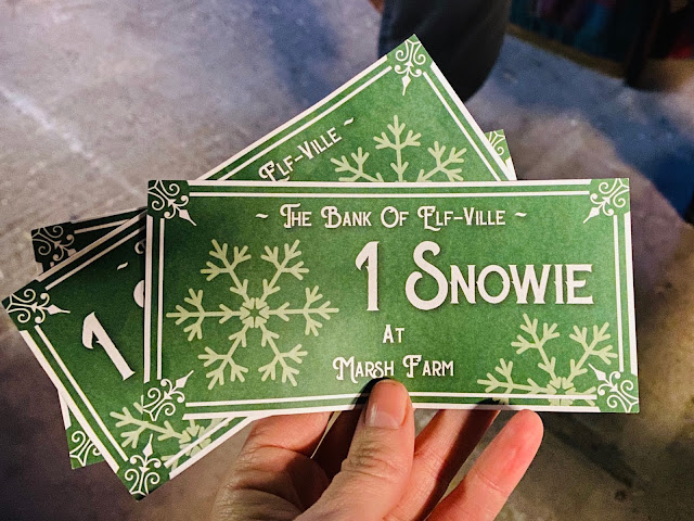 "3 snowies which are sheets of paper saying ""the bank of elf-ville 1 snowie at Marsh Farm"""
