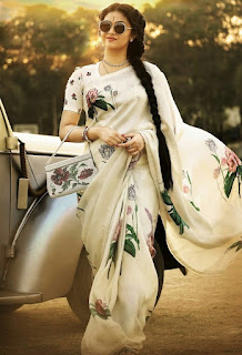Keerthy Suresh in White Saree with Cute and Awesome Lovely Chubby Cheeks Smile in Mahanati