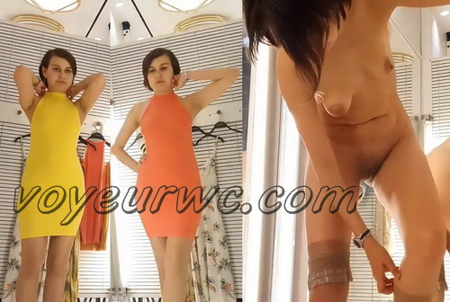 SpyCam 2497-2506 (Shopping Mall changing room. Hidden cam - Girl trying on swimsuits and dresses)