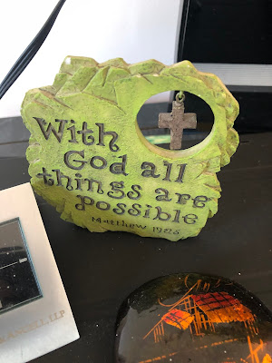 """Wooden knickknack with cross, says """"With God all things are possible, Matthew 19:26."""""""