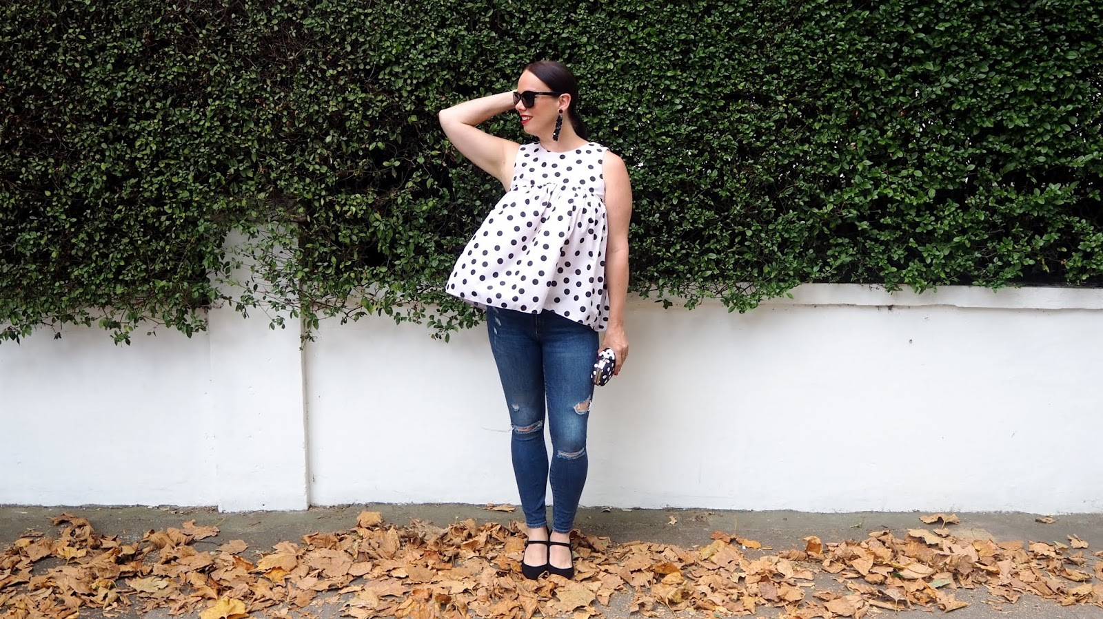 polka dot taffeta top with ripped jeans, contrasting clutch and black maryjane heels