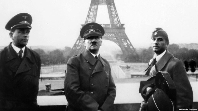 2482f974c7f883 39) Heinrich Hoffmann, Picture of Adolf Hitler at the esplanade of the  Trocadéro, with the Eiffel tower in the back, between Albert Speer (left)  and Arno ...