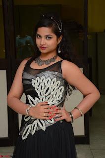 Shrisha Dasari in Sleeveless Short Black Dress At Follow Follow U Audio Launch 051.JPG