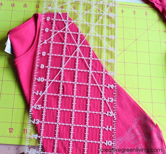 Lay your straight edge or quilting ruler at an angle in order to cut off the sleeves.
