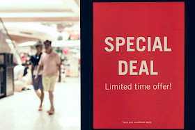 Red poster in a supermarket that says sale limited time offer