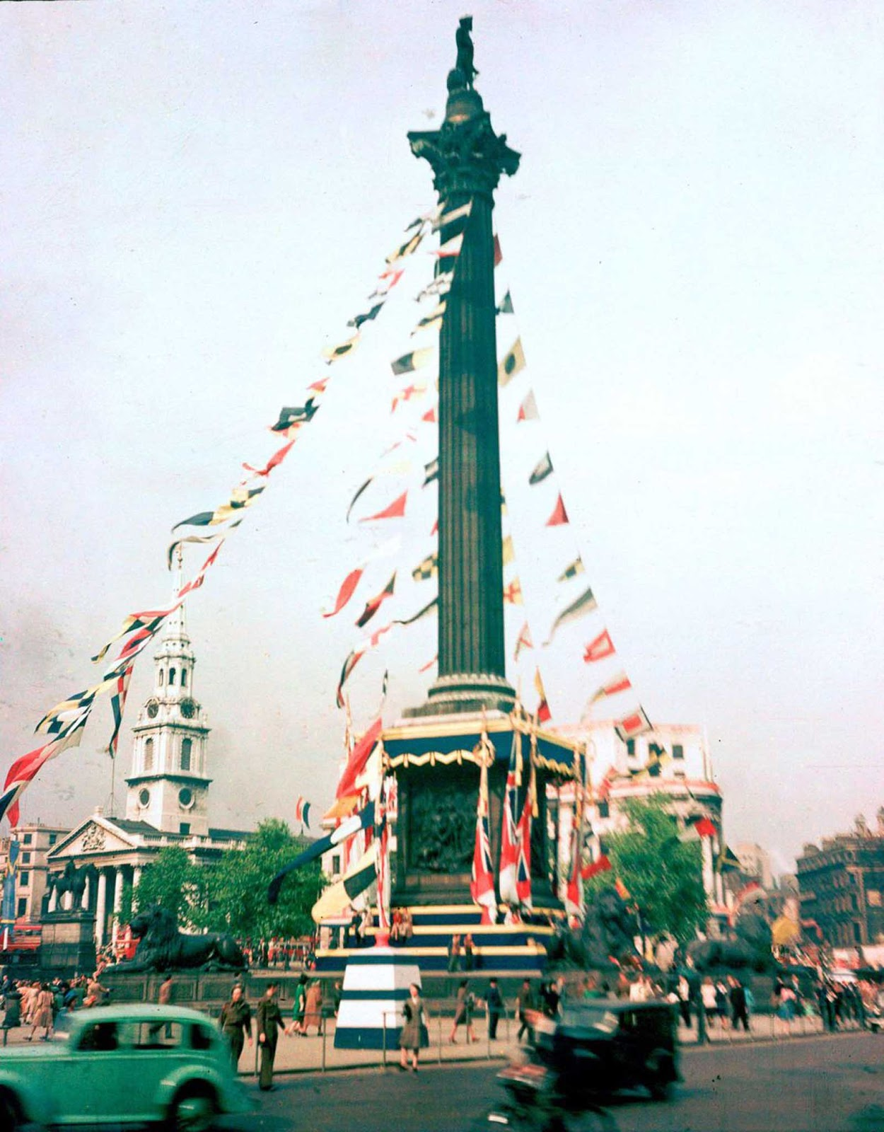 Nelson's Column festooned with flags to celebrate VE Day. Sept. 3, 1945.