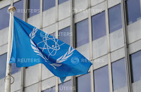 The flag of the International Atomic Energy Agency (IAEA) flutters in front of their headquarters in Vienna, Austria March 4, 2019 (Credit: pictures.reuters.com0) Click to Enlarge.