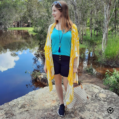 awayfromblue Instagram | yellow kimono with turquoise tank and black denim shorts sneakers lv neverfull tote walk around bush trail outfit