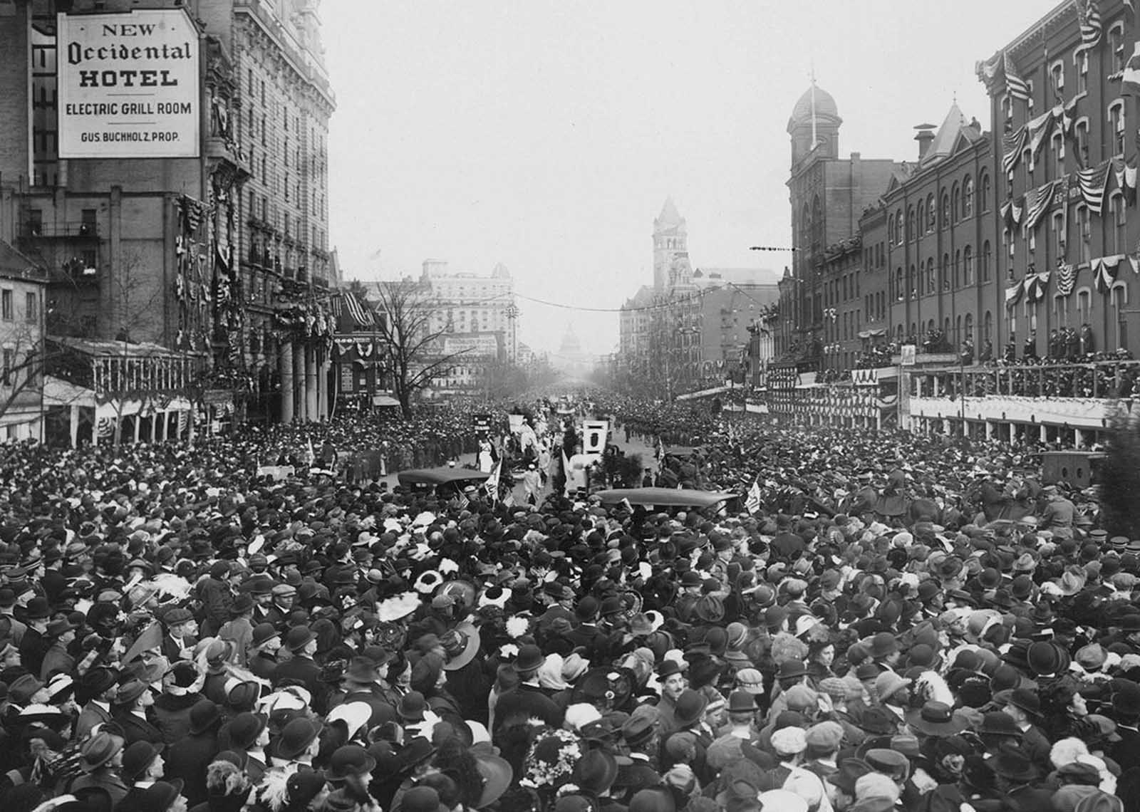 The crowd converges on marchers, blocking the parade route during March 3, 1913, suffrage procession, in Washington, District of Columbia.