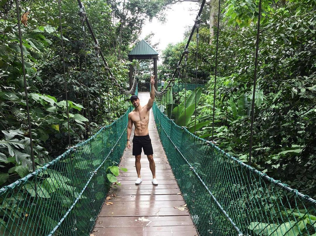 shirtless-fit-dude-sixpack-abs-smiling-walking-nature-cool-hidden-mini-bridge-forest